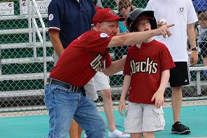 Miracle Leaguer getting instruction