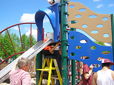 Volunteers construct the playground named the Favre Family Miracle Recreation Area.